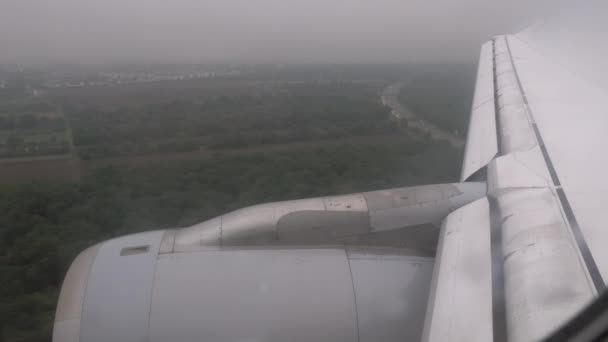 View from inside the plane which landing at the airport