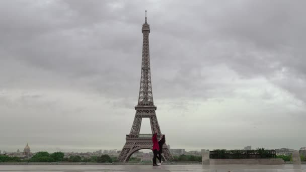 Female tourists at the observation deck overlooking Eiffel Tower, Paris