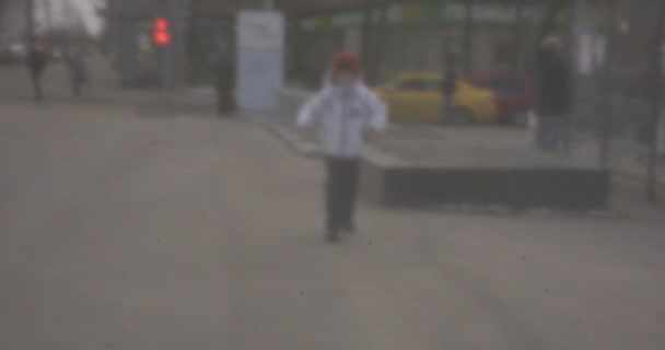Happy child running to the camera, retro style video
