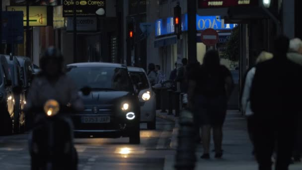 Car and people traffic in night street, Spain