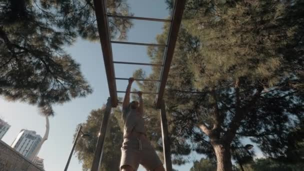 Workout on monkey bar in the park