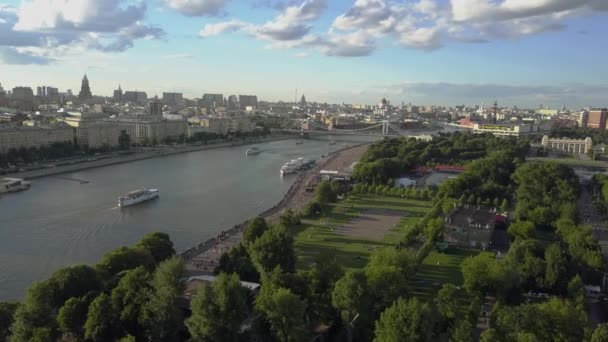 Moscow scene with river, park and bridge. Aerial view