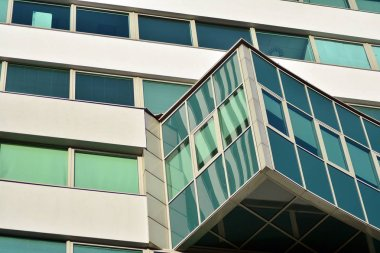 Facade fragment of a modern office building. Exterior of glass wall with abstract texture.