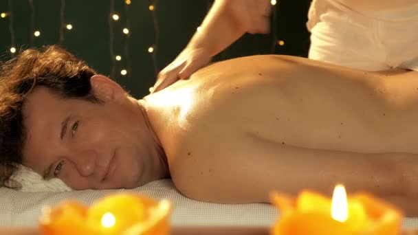Happy man receiving massage ok sign looking camera