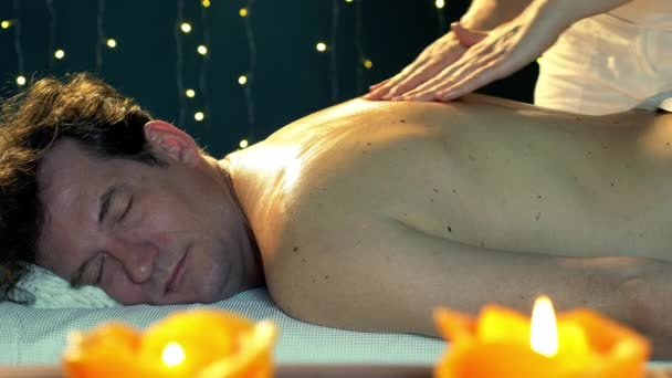 Handsome man in vacation in hotel getting back massage relaxing