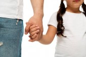 Fotografie ostříhané zobrazení otce a chlapce držící ruce izolované na bílém