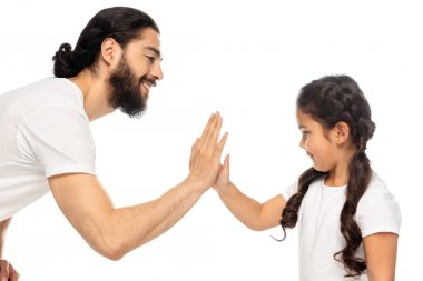 cheerful latin father giving five to cute daughter isolated on white