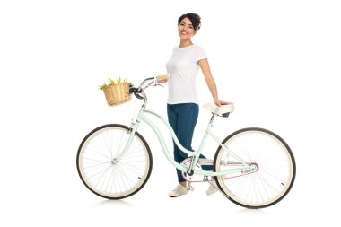 Cheerful latin woman standing with bicycle isolated on white stock vector