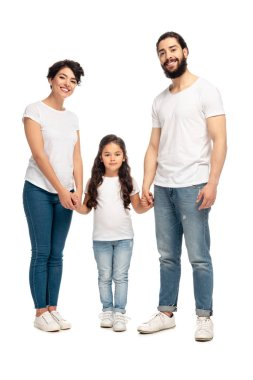 latin parents holding hands with adorable daughter isolated on white