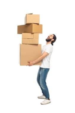 Happy bearded latin man holding carton boxes and smiling isolated on white stock vector