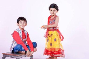 cute Indian brother and sister celebrating raksha bandhan festival ,
