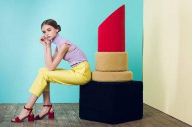 beautiful elegant teen girl posing with big red lipstick
