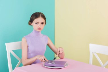 beautiful teen girl with book on plate, education concept