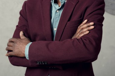 cropped view of stylish african american man with crossed arms in burgundy jacket