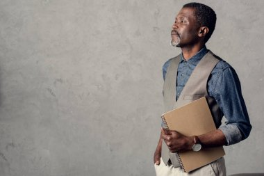 handsome middle aged african american businessman with planner