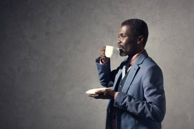 mature african american man drinking coffee from cup