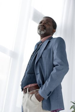 bottom view of mature african american man in blue jacket