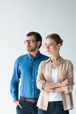 young man and woman in stylish clothing and eyeglasses isolated on white