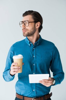 Confident young man with paper cup of coffee and tablet isolated on white stock vector