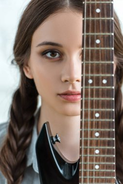 attractive youth girl with electric guitar