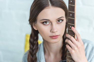 attractive caucasian teen girl with electric guitar