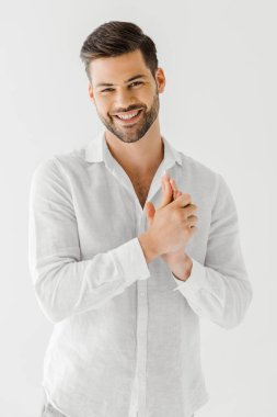 portrait of smiling man in linen white shirt isolated on grey background