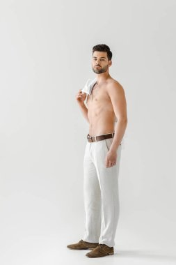 topless handsome man posing with shirt on shoulder isolated on grey background