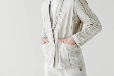Cropped shot of man in vintage striped jacket with hands in pockets isolated on white stock vector