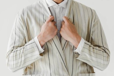 cropped shot of man in vintage striped jacket isolated on white
