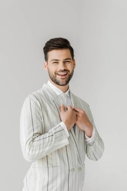 happy young man in vintage striped jacket on white