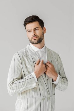 handsome young man in vintage striped jacket on white