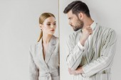 Fotografie passionate young male and female models in vintage jackets looking at each other on white