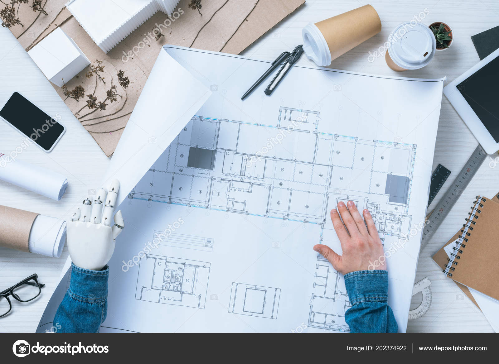 Cropped image male architect prosthetic arm working blueprint table cropped image male architect prosthetic arm working blueprint table smartphone foto de stock malvernweather Gallery