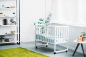 Photo interior of modern light childrens room with crib