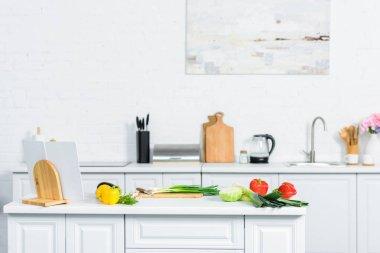 Vegetables on kitchen counter in light modern kitchen stock vector