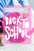 Fotografie cropped shot of child packing pink school bag at home, welcome back to school concept