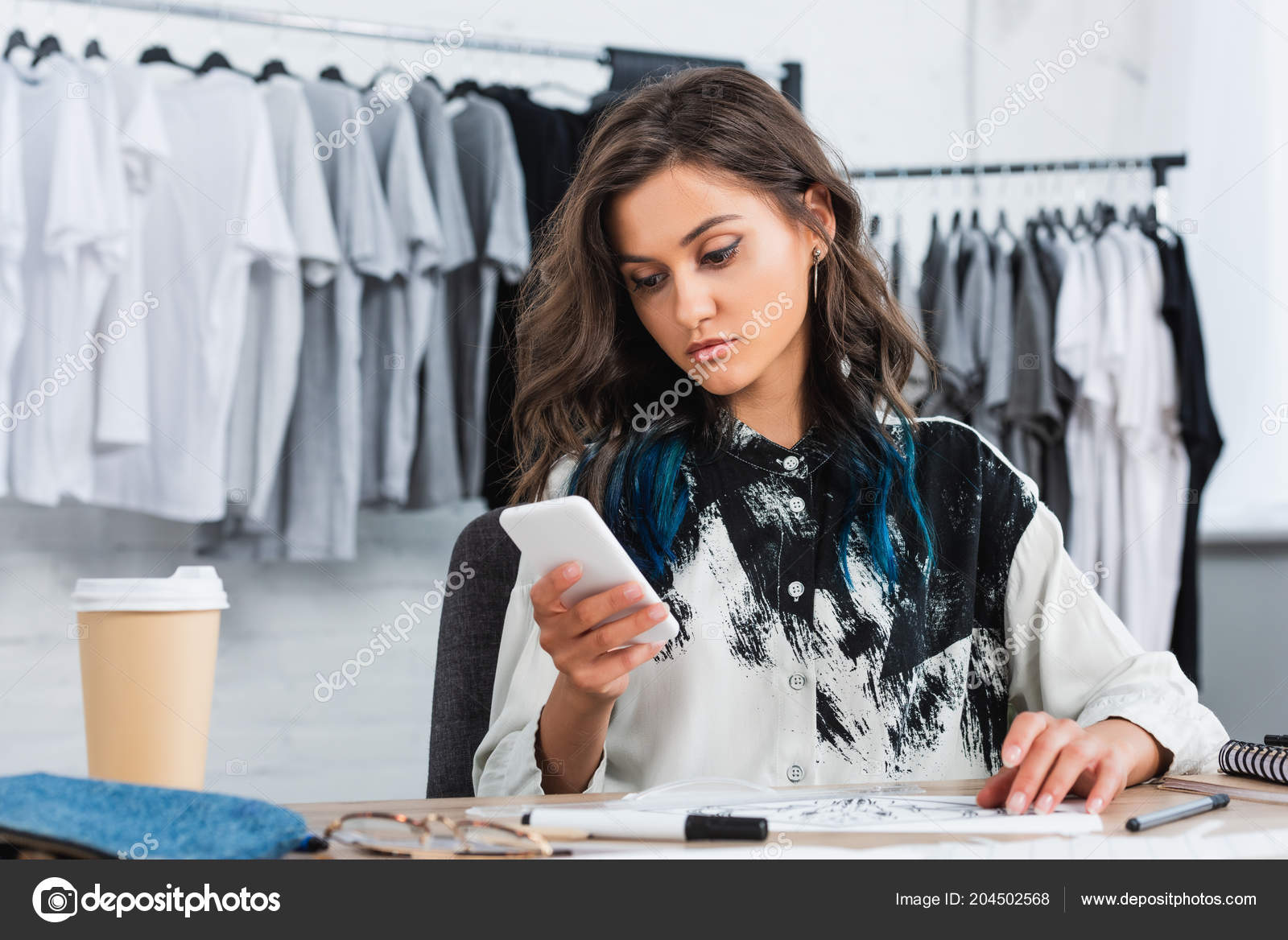 Attractive Young Female Designer Using Smartphone Working Table Clothing Design Stock Photo C Andrewlozovyi 204502568