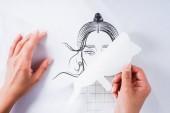 cropped image of female fashion designer doing print on white t-shirt