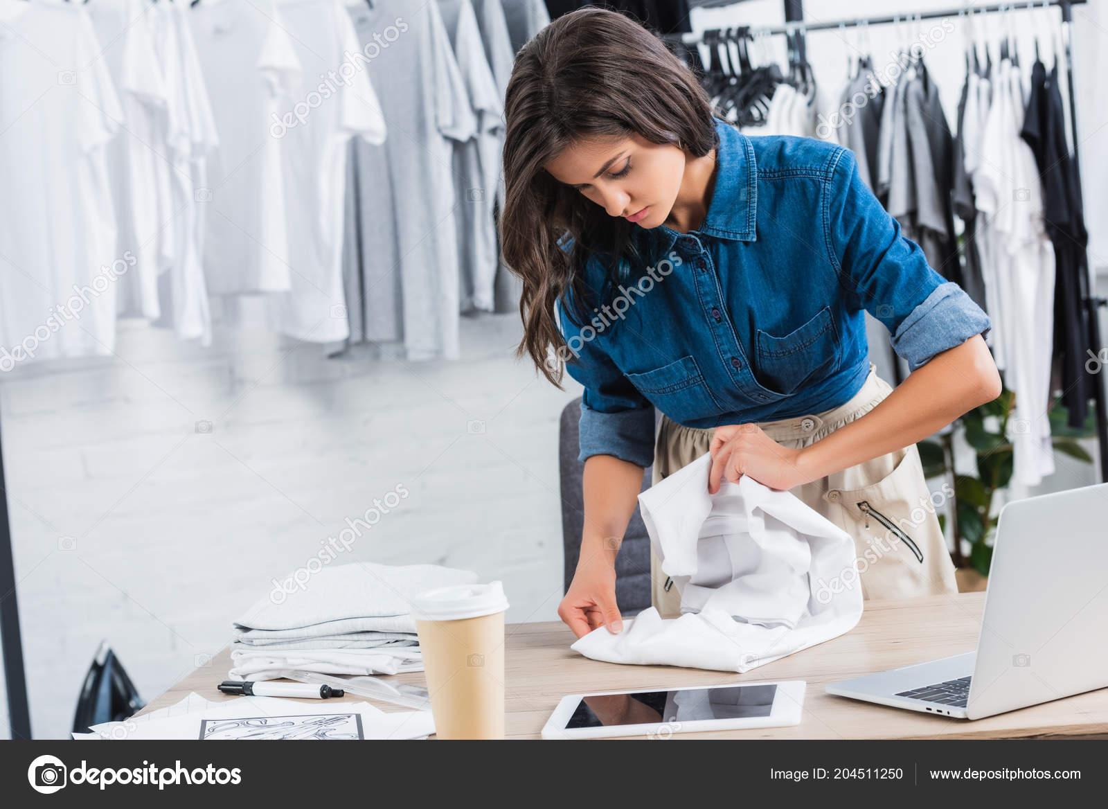 Female Fashion Designer Folding Shirt Table Coffee Digital