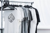 Fotografie selective focus of t-shirts with print on hangers in clothing design studio