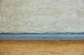 Fotografie bílé a hnědé betonové zdi texturou pozadí