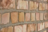 close-up view of old weathered brick wall textured background