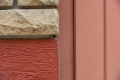 close-up view of bricks, red wall and wooden planks background