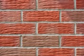 Fotografie close-up view of red weathered brick wall, textured background