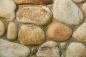 Detailní pohled zvětralé kamenné zdi textury, pozadí plnoformátový