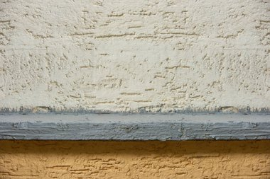 close-up view of white and brown concrete wall textured background