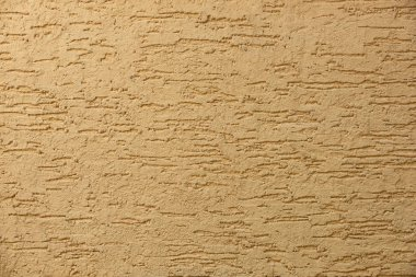 close-up view of light brown concrete wall textured background