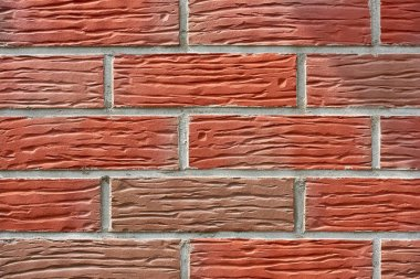 Close-up view of red weathered brick wall, textured background stock vector