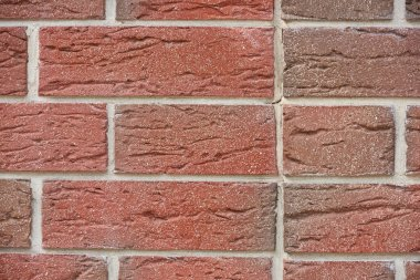 full frame view of red weathered brick wall, textured background