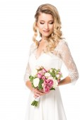 attractive young bride with bouquet isolated on white